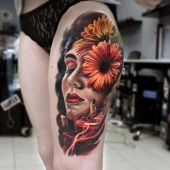 thigh tattoo face and flowers