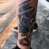 bat tattoo on leg