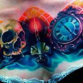 skull clock chest tattoo