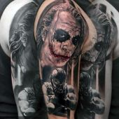 joker and  bane tattoo