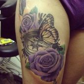 butterfly and flowers thigh tattoo