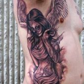 man with angel tattoo on rib
