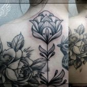 black & grey flower tattoo