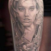 thigh tattoo woman face