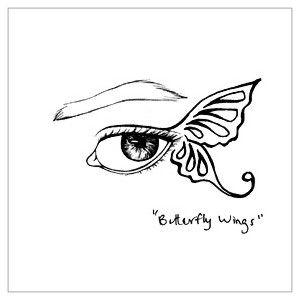 oko ze skrzydełkiem tatuaż