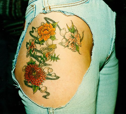 flowers thigh tattoo for girl