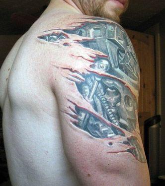 tatuaż biomechanicznyny na ramie