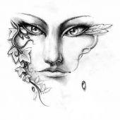 twarz kobiety w roślinach tatuaż