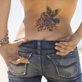 lower back tattoo bird