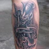 alien leg tattoo