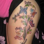 butterfly flowers thigh tattoo