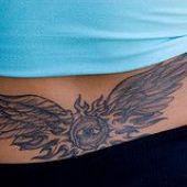 lower back tattoo wings eye