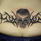 lower back tattoos skull and tribal