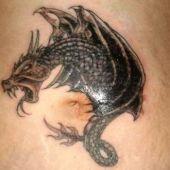 stomach tattoo dragon