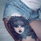 face tattoo thigh