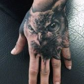 owl hand tatoo