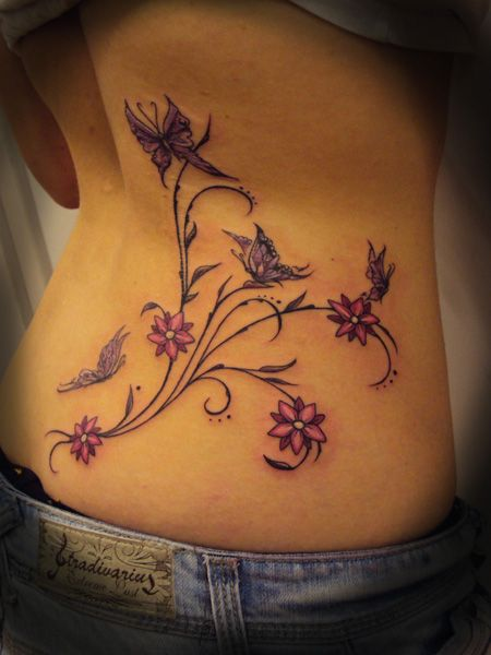 lower back tattoo butterflys flowers