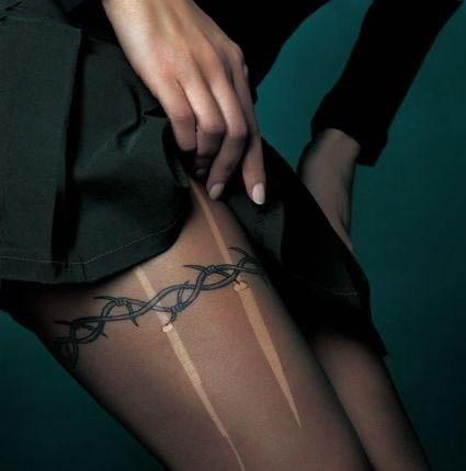 thigh ring tattoo