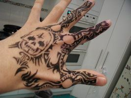 hand tattoo skull tribal