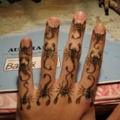 scorpions hand tattoo