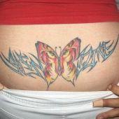 lower back tattoo tiger eye